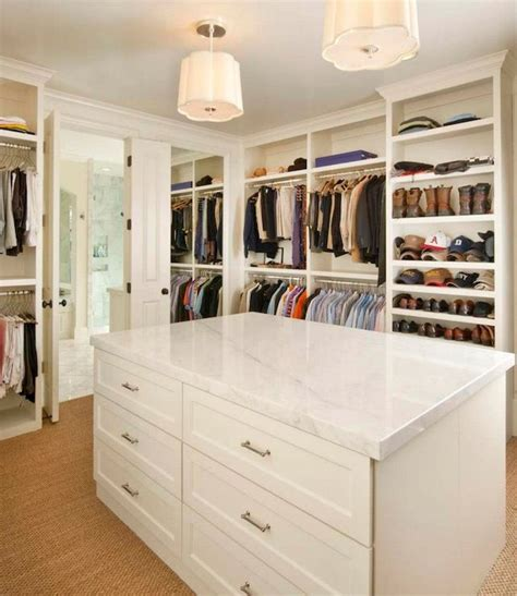 stunning walk in closet with floor to ceiling shelving and