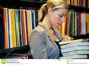 Woman Reading In A Library Stock Images - Image: 26480534