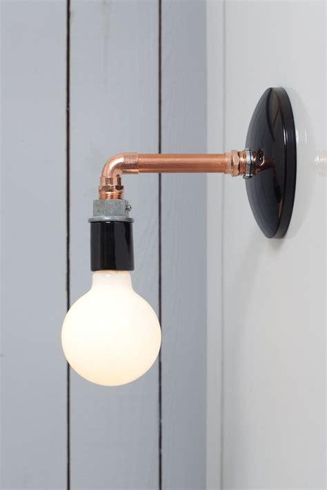 copper pipe wall sconce light bare bulb l