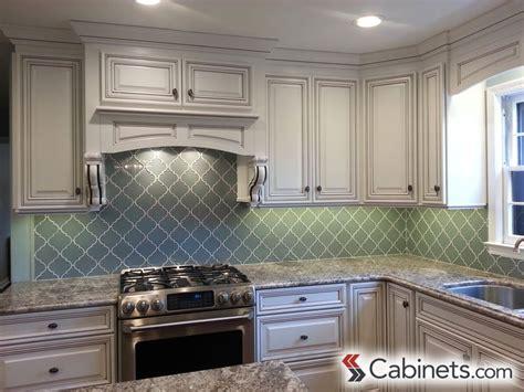 bright white cabinets paired  aqua backsplash