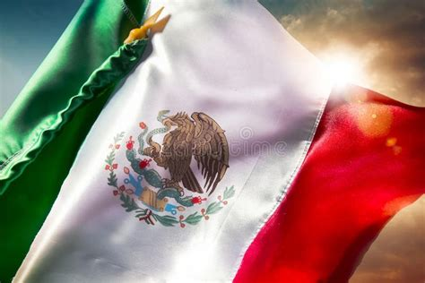 Mexican flag against a bright sky, independence day, cinco ...