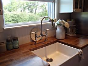 kitchen faucets with sprayer in rustic farmhouse a farm style sink