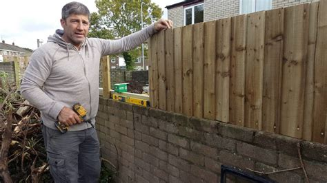 How To Install A Feather Edge Fence On Boundary Wall - YouTube