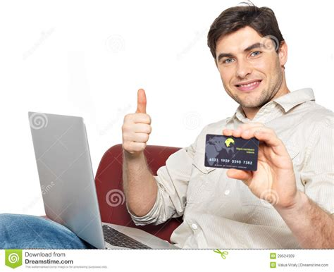 Maybe you would like to learn more about one of these? Man With Laptop Shows The Credit Card Royalty Free Stock Images - Image: 29524309