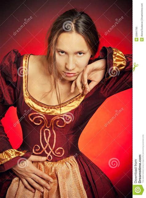 medieval girl   maroon dress stock  image