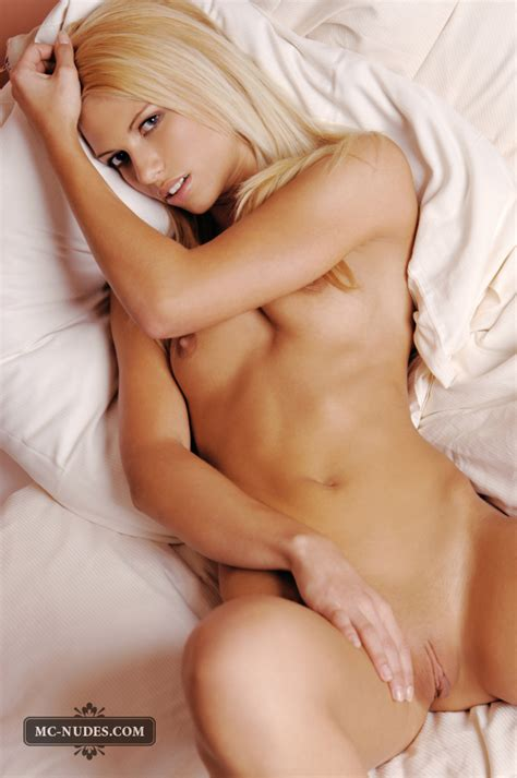 Beautiful Blonde Evi on Bed Exposing Her Nude Body with