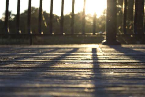 picture sun wooden planks wooden floor shadows