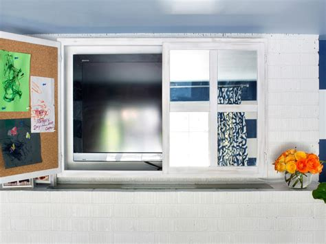 kitchen cabinet tv turn a kitchen cabinet into a flat screen tv cover hgtv 6346