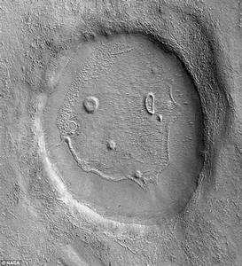 A happy day on Mercury: Crater that looks like a smiley ...
