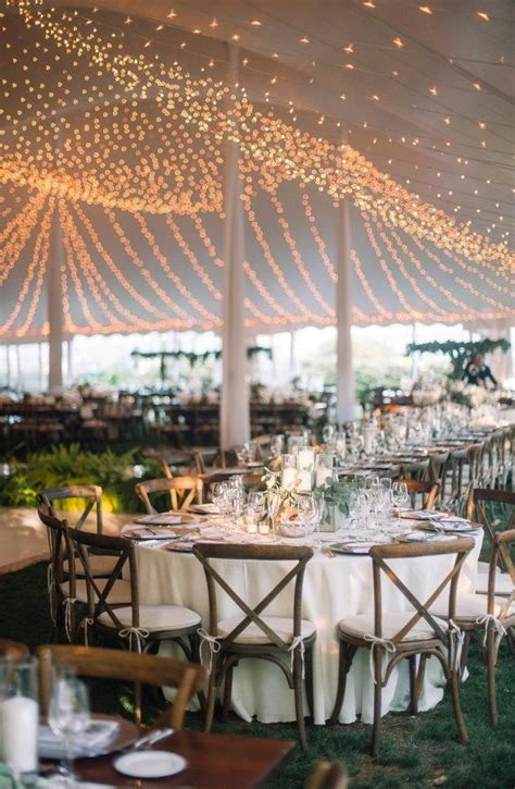 rustic fall wedding wedding string lights and tent