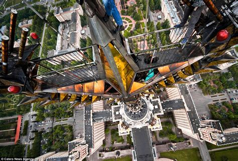 russian daredevils climb  countrys tallest buildings