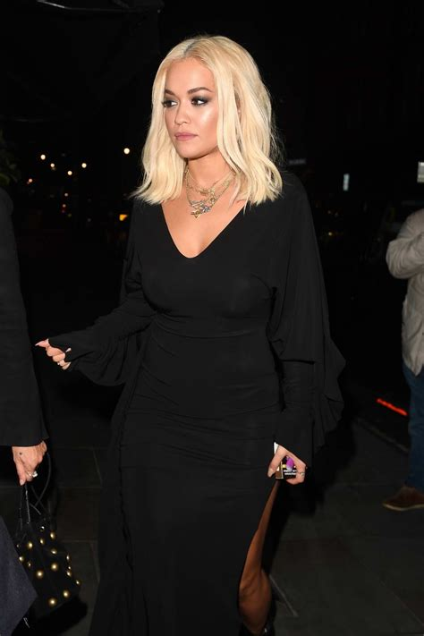 rita ora seen wearing a black dress while out to dinner at ...