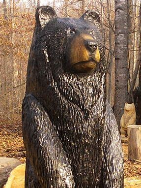 hand crafted large black bear wood sculpture  sleepy