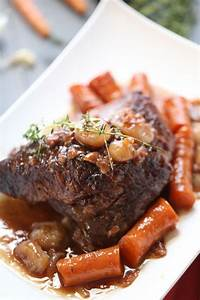 Braised Beef Brisket Is Slow Cooked With Vegetables And A