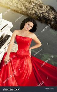 Beautiful Slim Bride In Red Wedding Dress Playing Grand