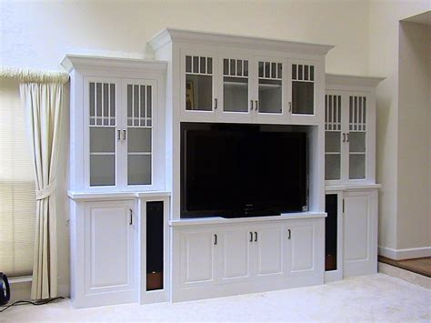 tv and storage unit decorating the entertainment corner with built in wall