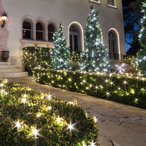 how to attach net lights to hedges net lights yard ideas light decorations net lights lights