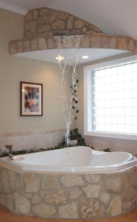 Spa Tubs For Bathroom by A Waterfall Fills This Corner Tub In A Master