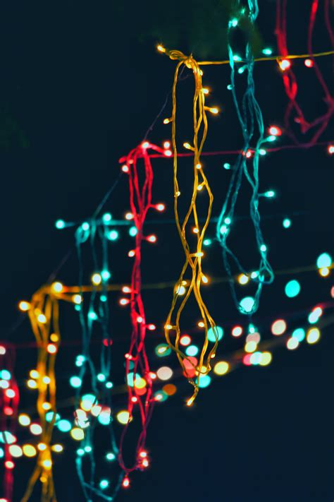 assorted color string lights  dark room  stock photo