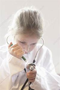 Girl playing doctor with stethoscope - Stock Image F006 ...