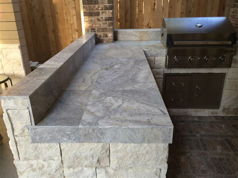 houston outdoor kitchen  silver travertine tile countertop