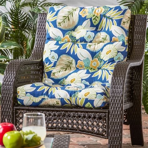 wicker woven chair  cool blue floral pattern cushion