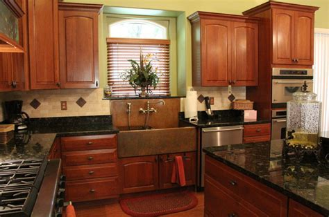 Copper sink, copper accented backsplash, dark countertops