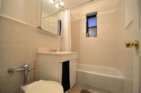 02 Tiny Apartment Clean Bathroom With Small Window For