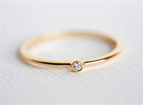 How To Buy An Engagement Ring — Gentleman's Gazette. Solitaire Diamond Engagement Rings. Lotus Rings. Wedding Ring Rings. Lapis Rings. Flexible Wedding Rings. Mammoth Ivory Wedding Wedding Rings. Partner Engagement Rings. Toy Rings