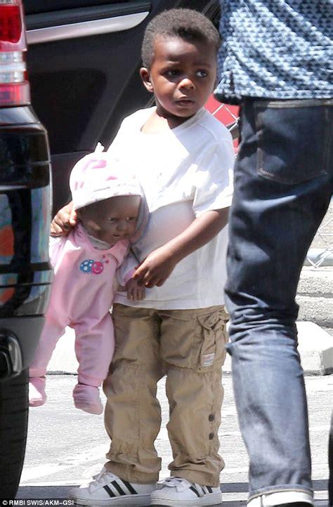 Sandra Bullock and son Louis Bardo show off their summery ...