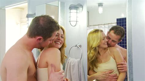 Young Couple Being Playful And Romantic In Bathroom Stock
