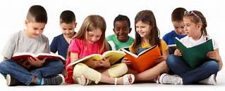 Group of school kids sitting in a line while reading books