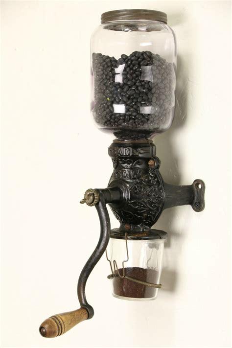 sold arcade crystal  antique wall coffee grinder