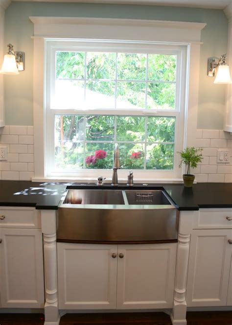 Kitchen Window Backsplash by The Detail Around The Window And The Sconces Flanking