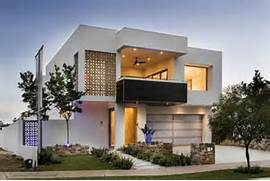 Empire House Embraces Modernist Style With A Contemporary Touch Modern House Exterior With Balcony Landscaped Garden House Facade Braxton And Yancey Mid Century Modern Homes D Coration Fa Ade Maison Id Es Modernes Et Jolies