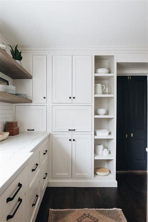 Our shaker white kitchen cabinet line combines the sleek lines you love with an elegant white finish to create a one of a kind kitchen design. Stacked white shaker kitchen cabinets accented with oil ...