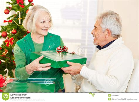 senior citizens celebrating christmas with gifts stock