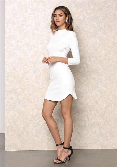 white lace form fitting dress wedding guest