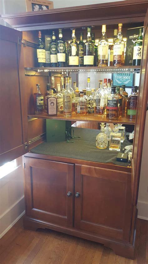 diy liquor cabinet diy converted a tv hutch into a lit up liquor cabinet
