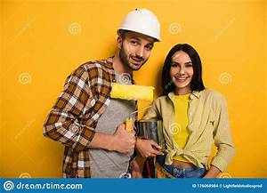 Manual Workers With Paint Roller And Stock Photo