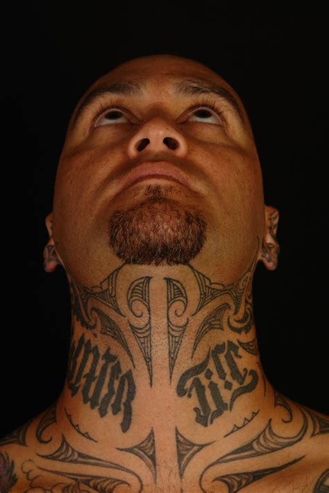 maori polynesian tattoo tiki taane throat tattoo
