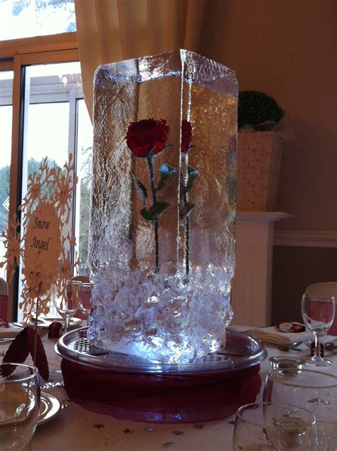 ice sculpture table centrepiece single red rose  ice