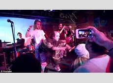 Macaulay Culkin kisses Har Mar Superstar on stage in