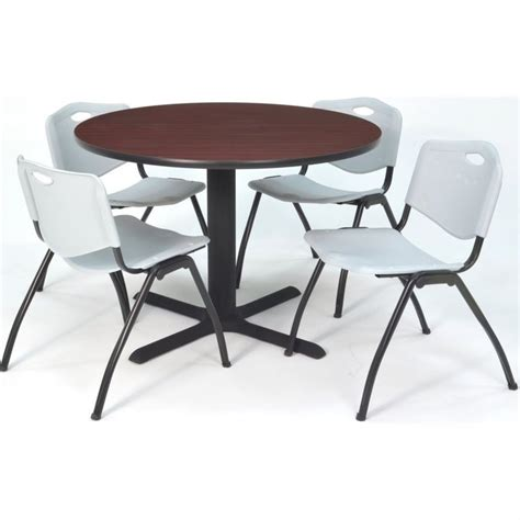 lunchroom table and 4 grey m stack chairs in
