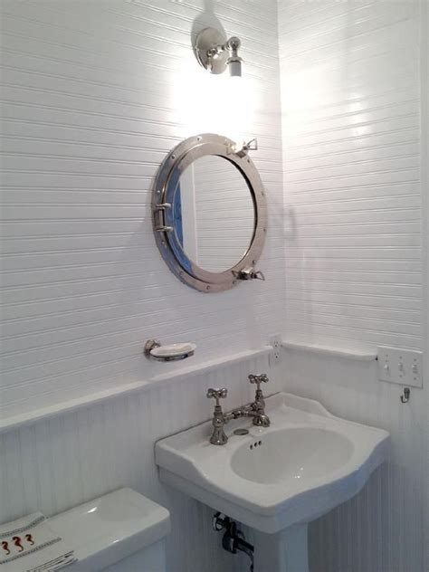 white cottage bathroom features upper walls clad in