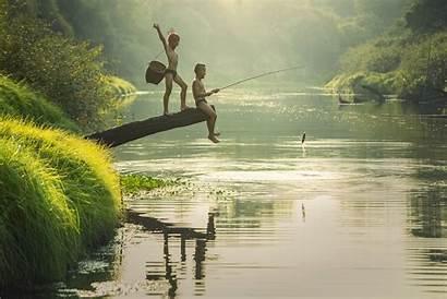 Fishing River Boy Sitting Beside Log While