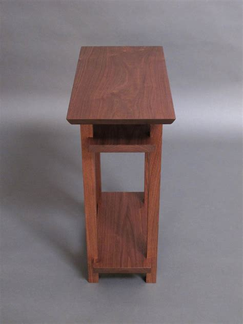 small narrow wood table with two shelves small side table