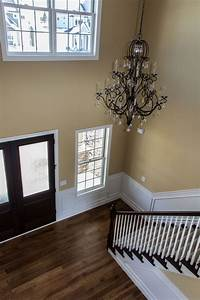 Ldk, Front, Entry, With, Eye, Catching, Chandelier, Lighting, And, Striking, Color, Schemes