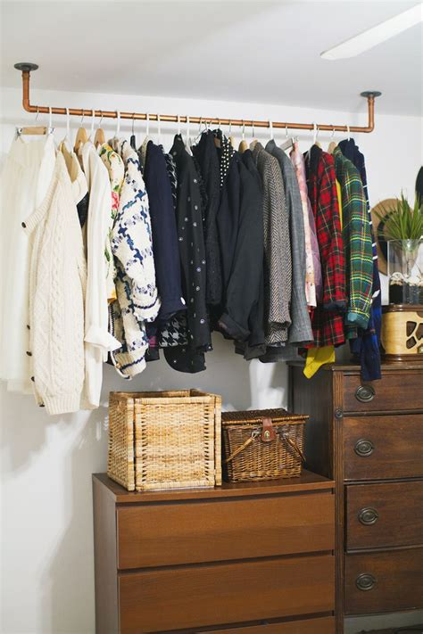hanging copper pipe clothing rack diy  beautiful mess