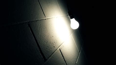 light bulb swaying  wall  dark room stock footage video  shutterstock
